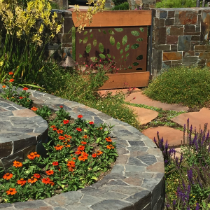 curved stone spiral planting bed
