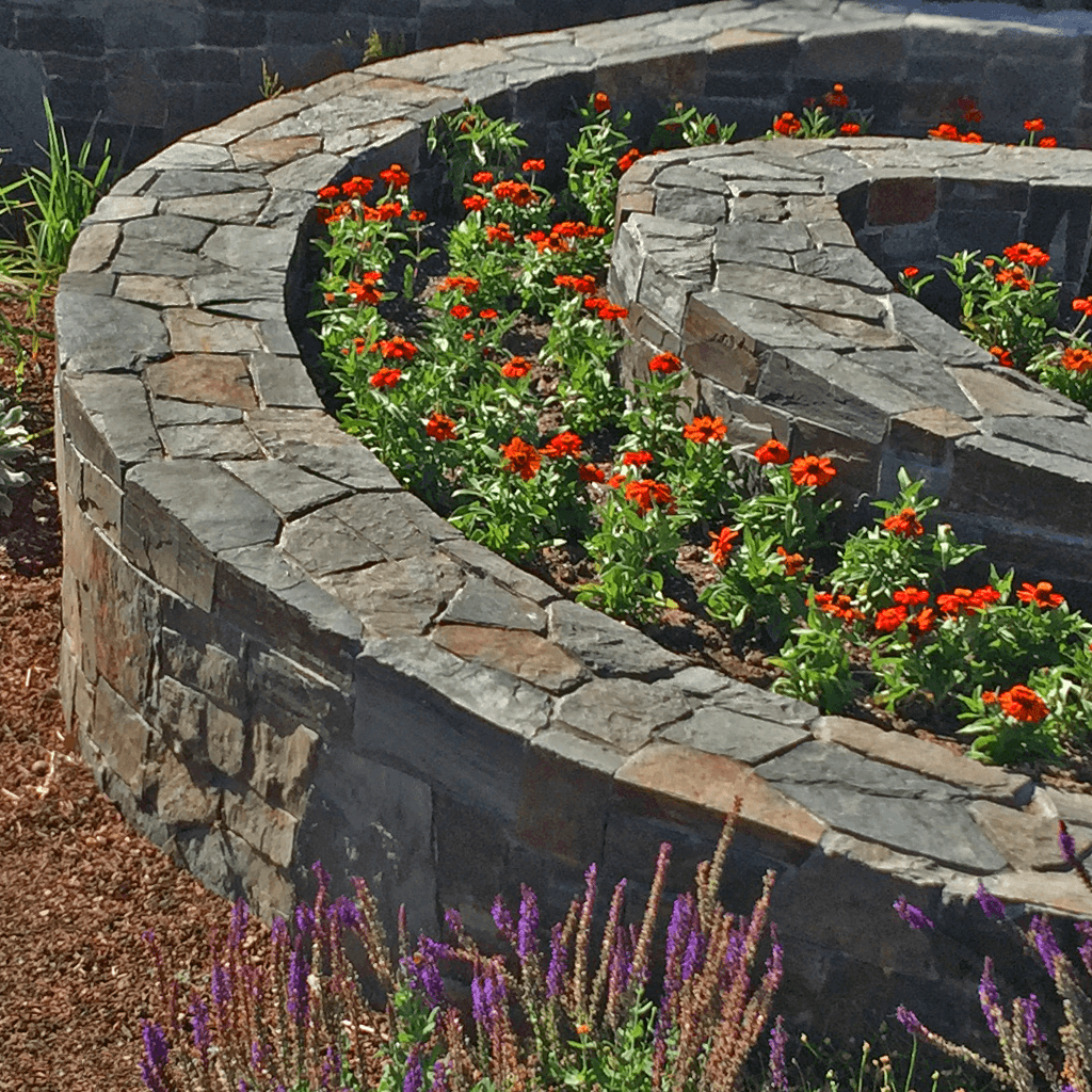 garden design spiral curved stone wall