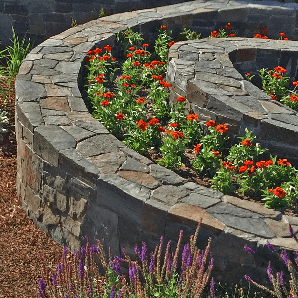 garden design spiral curved stone wall